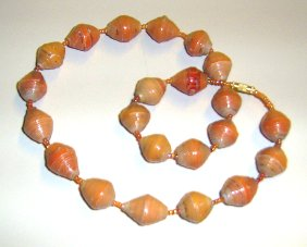 coral and orange tones in this necklace of paper beads from Uganda