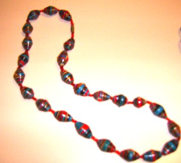 vivid reds and blues in this Ugandan necklace of shorter length