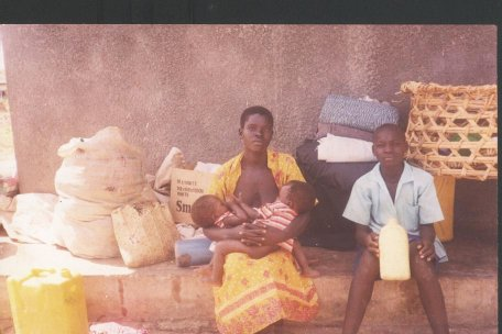 a woman with twins starving in the camps